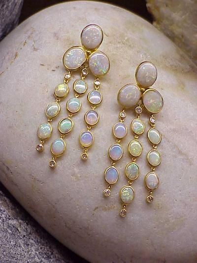 22k yellow gold and opal. Bought and worn by Elizabeth Taylor.