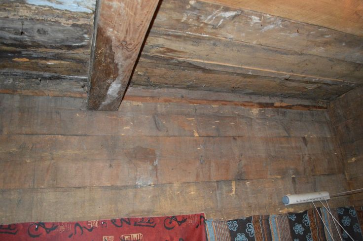 Inside the white lived in 19th century log house showing the end storage room with original timber 150 years old maybe...