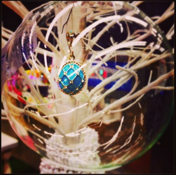 Very classic with a twist! Here is The Cosmos Crown in blue at a jewelry show presentation, in a glass ball. Very unique! Currently in stock on our website in black !! :)