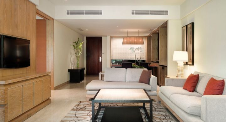 Separate living and dining area at Conrad Suites where guests could relax and enjoy complimentary WiFi