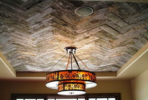 Wood ceiling ideas reclaimed snow fence wood adds interest to ceiling for his house - Recycled interior design ideas ...