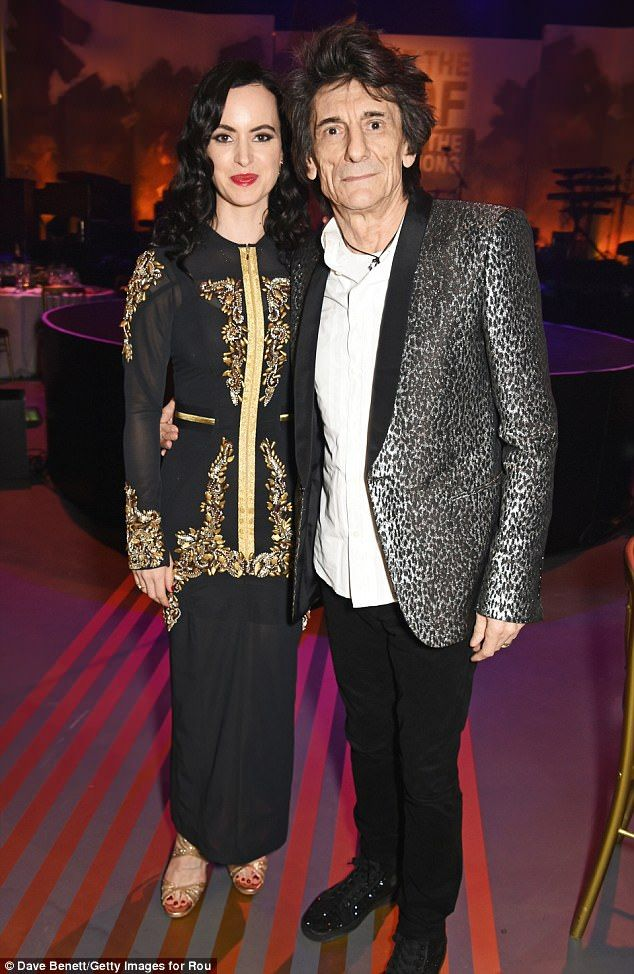 Chirpy: It came as no surprise to see Ronnie Wood, 69, and wife Sally, 39, looked in good spirits as they let their hair down at the Roundhouse Gala at The Roundhouse in London on Thursday