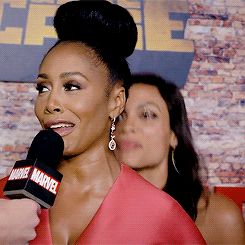 Rosario Dawson throwing hearts and air kisses to Simone Missick at the Luke Cage premiere