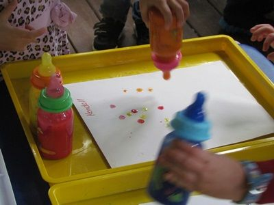 Baby bottle painting - since the bottles don't squeeze, the only way to get the paint out is by manipulating the nipple - great fine motor activity. Might also be a fun way for a little one to give up the bottle.