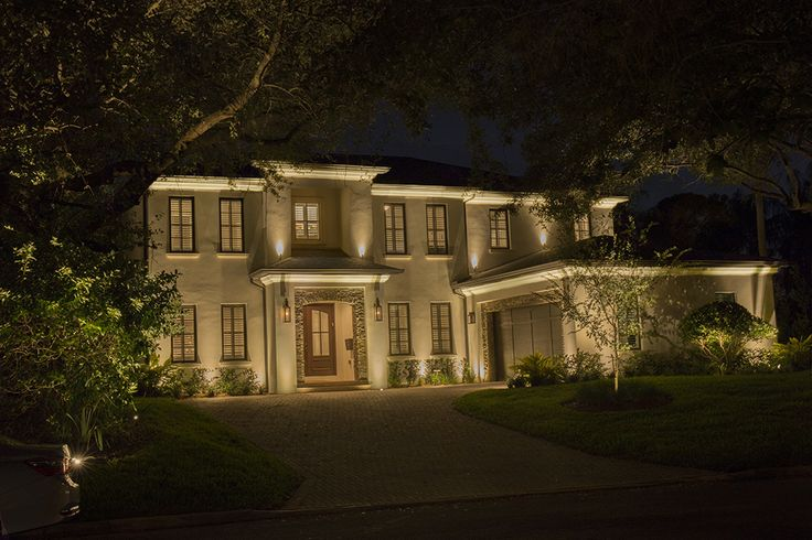 Beautifully illuminated house— courtesy of VOLT Landscape Lighting!