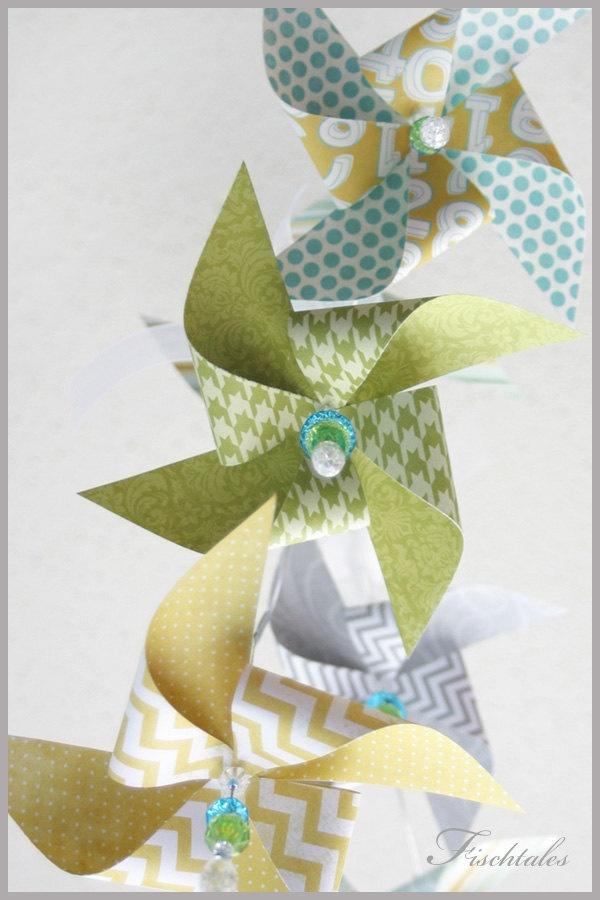 Green, Yellow, Blue,and Grey Modern Pinwheel Mobile. $85.00, via Etsy.