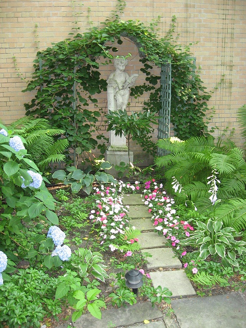 Garden statue and arbor