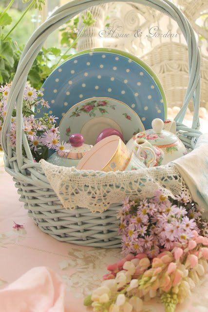 shabby sweet basket - nice way to display vintage china, cups, etc.