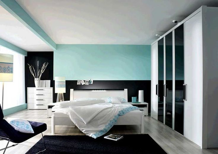 Large Modern Bedroom Cupboards with black blue wall paint colors and white bed frames also bedding sheets and black plush carpet also wooden floor