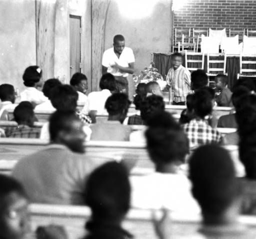Boys addressing an audience at Harrison Street Baptist Church in Greenville, Alabama, during a student boycott of the Greenville Training School. :: Jim Peppler Southern Courier Photograph Collection
