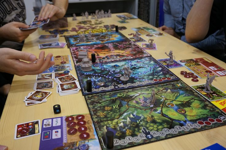 12 Realms: Game in Progress. A big thanks to the fans who post these pictures from Essen.  We already created a FAQ. Next week we will post it here on our website, on BGG and other online places. We made it in English and we wait the translation in German.  Until Christmas we will have ready the rules in French and the FAQ in French and Italian.