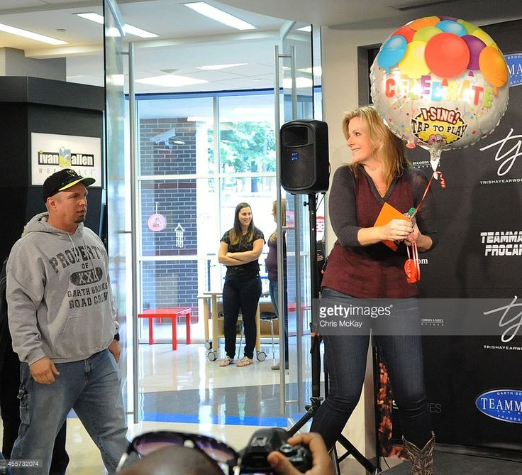 Garth Brooks and Trisha Yearwood attend a press conference at Children's Healthcare of Atlanta at Scottish Rite on September 19, 2014 in Atlanta, Georgia.