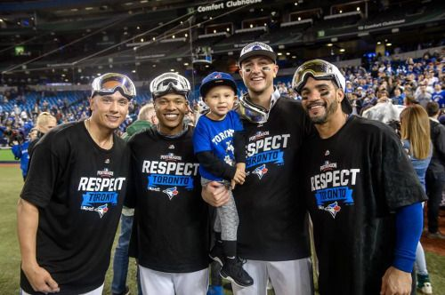 Ryan Goins, Marcus Stroman, Taz & Troy Tulowitzki & Devon Travis on the field at Rogers Centre after the Jays won the ALDS