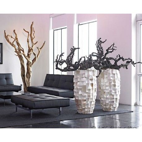 sandblasted ghostwood (left) and vine branches in contemporary textured pots