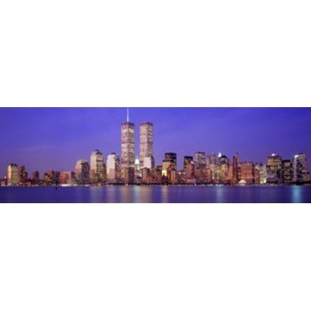 Buildings at the waterfront lit up at dusk World Trade Center Wall Street Manhattan New York City New York State USA Canvas Art - Panoramic Images (36 x 12)