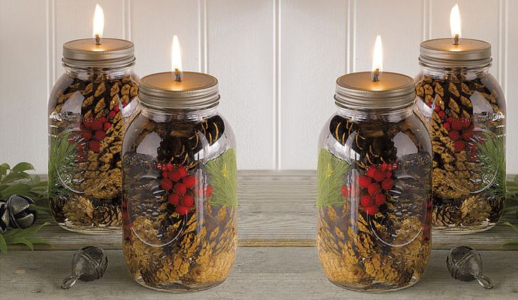 These cool new Winter Forest Mason Jar Oil Candles are clean-burning oil candles infused with decorative pinecones, pine needles and holly berries all sealed up inside mason jars. They feature special fiberglass wicks that never need replacing, use smokeless, odorless paraffin liquid and have a 32 hour burn time.