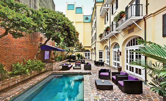 The pool and outdoor bar at Hotel Le Marais, in New Orleans. Like many French Quarter spots, there is plenty of flash: The lobby is all bright colors, mirrored tiles, and party music.