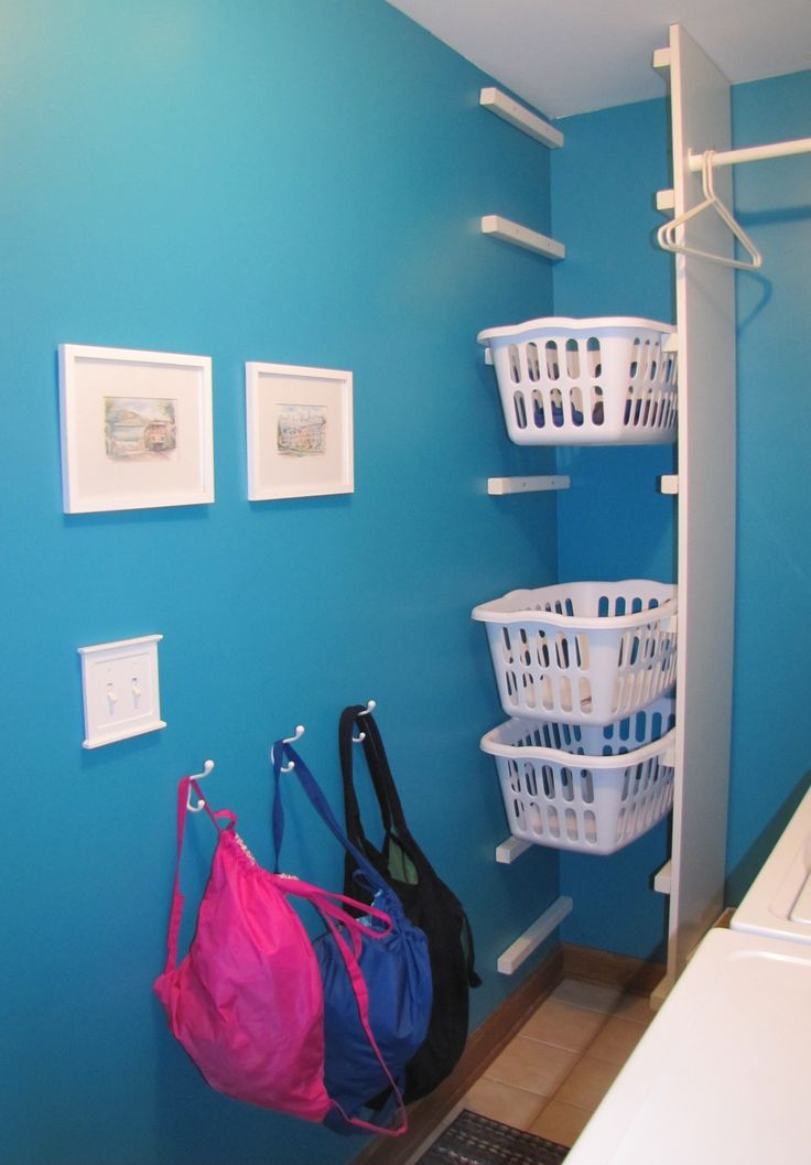 laundry closet idea... In the morning the kids bring down their dirty clothes, and after school they take their basket upstairs. If it isn't brought down in the am, mom doesn't do their laundry!