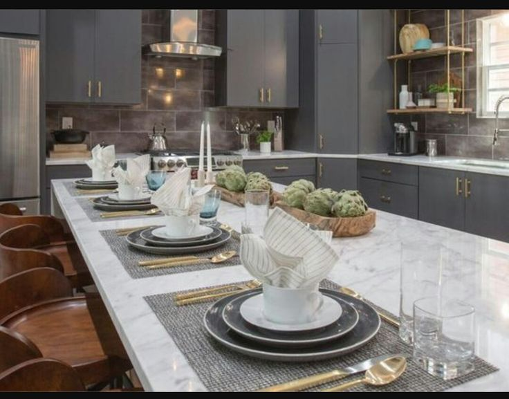 Beautiful kitchen by Drew Scott, Property Brothers.  I love the gold accents!