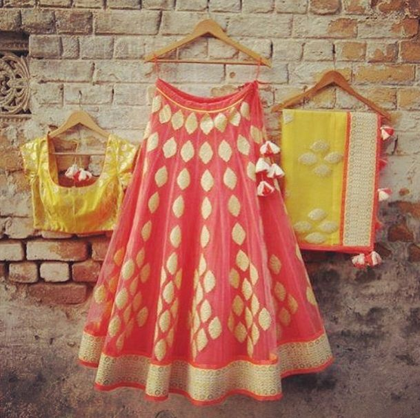 Fresh peachy colored lehenga with lemon yellow blouse and dupatta with minimalistic embroidery
