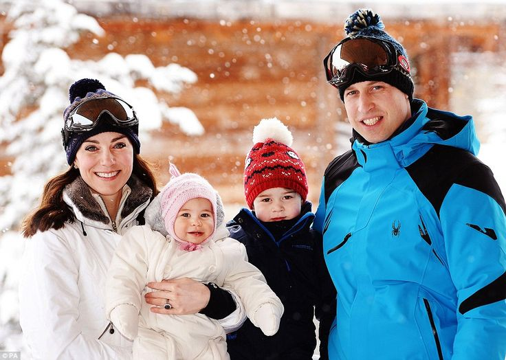 Wrapped up: The Cambridge family are seen standing in their ski gear with George and Charl...
