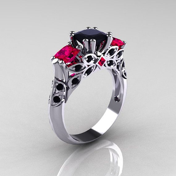 Love the design, the cut, and the black diamond with the rubies! It will be mine!