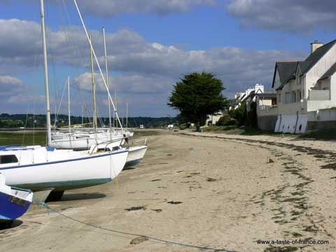 Houses and boats on the beach at Cap-Coz on the Finistere coast France