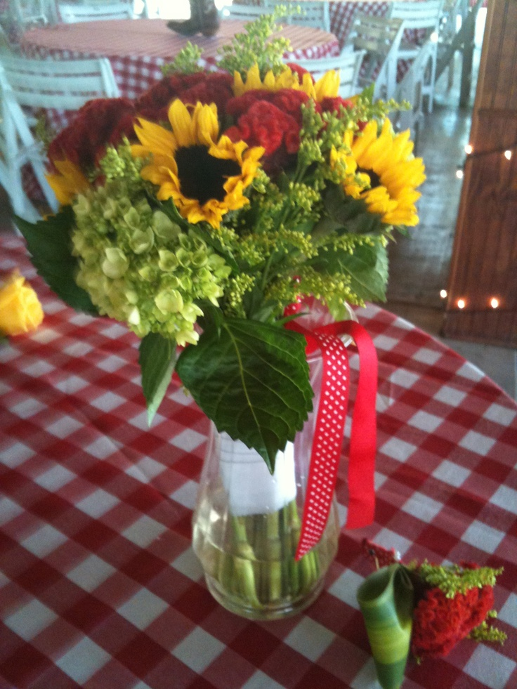 Graet for a country theme; sunflwers, hydrangea, solidago, and coxcomb, bridal bouquet