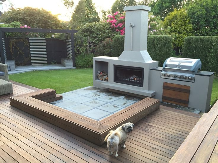 What a great outdoor area.  It's hard to say what draws your attention more, the great fireplace or the impressive BBQ!
