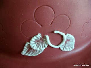 Brush Embroidery: Use cutters to gently form perfect flower outlines before applying the royal icing.