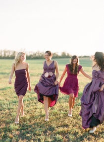 bridesmaid dresses- different dresses and shades of purple brings it all together and allows the girls to be unique
