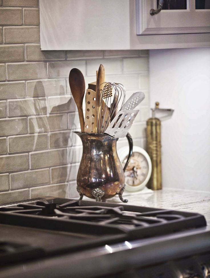 Cedar Hill Ranch Kitchen Tour and Confessions - Cedar Hill Farmhouse use an old silver pitcher as a utensil holder.