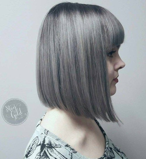 Silver A-Line Bob With Bangs.Bob Cut with Bangs  Truly, any regular old style can host the new hair trend. Beware as some cuts may age you – however, dark roots sort that out quickly and elegantly. It's a look that keeps on giving as your hair grows out too!