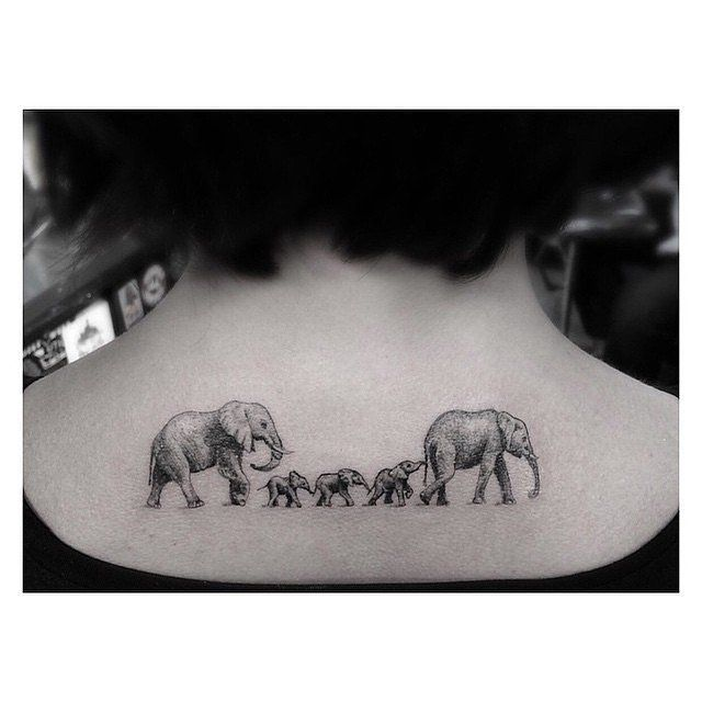 Forget the stick figures on the back window of your car, you can represent your family in a million other ways, like with this adorable elephant family tattoo. Image Source: Instagram user a_million_miles_