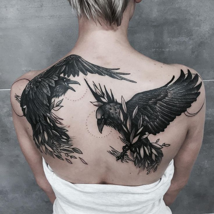 two ravens tattoo on the back