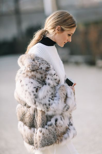 Olivia Palermo wears a fur coat a white top white pants boots and attends the Christian Dior Haute Couture Spring Summer 2017 show as part of Paris...