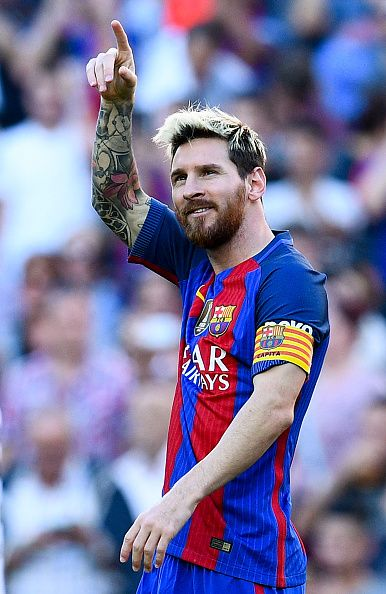 Lionel Messi of FC Barcelona celebrates after scoring his team's fourth goal during the La Liga match between FC Barcelona and RC Deportivo La Coruna...
