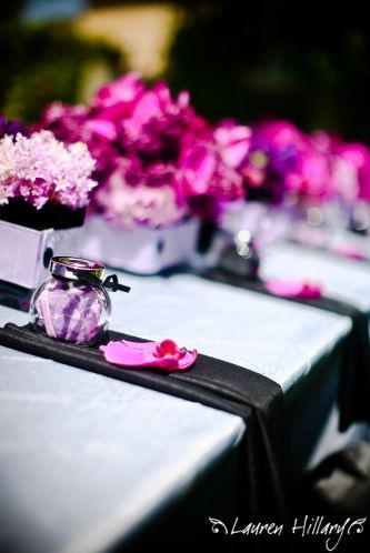 Boxes on table as centerpieces.  I would add White,Kelly Green and Watermelon pink flowers to boxes