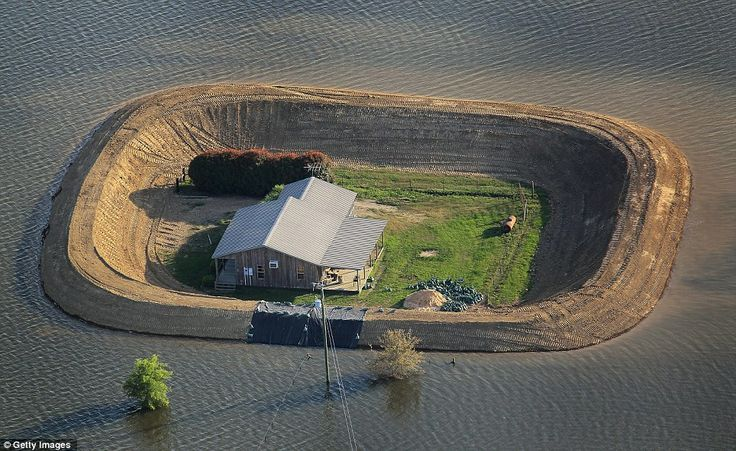 amazing homemade levees to stave off mississippi river flooding...