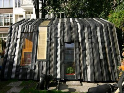 this house is made from repurposed wood and tires.