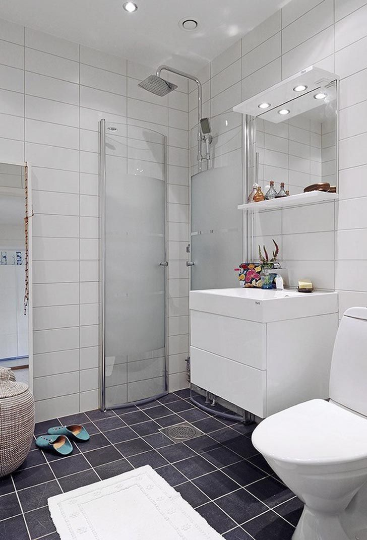 Scandinavian bathroom with open shower