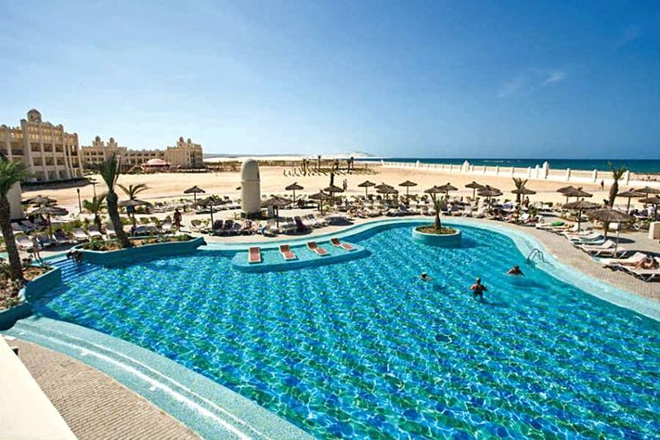 Pool beside the ocean at ClubHotel Riu Karamboa  Cape Verde's best beaches, island by island guide | Weather2Travel.com #travel #beach #capeverde #holiday