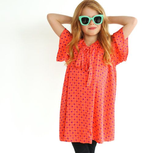I love sewing this Rosetta dress sewing pattern for kids. Easy girls pdf pattern made sewn in silk. Finished with a neck tie.