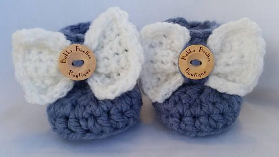 Handcrafted blue baby booties with white bow personalised