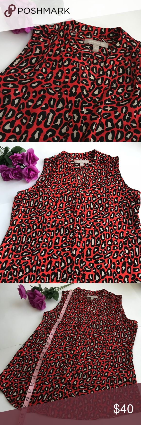 Banana Republic red animal print blouse LIKE NEW Banana Republic animal print top; great with dark blue jeans!  Size 2 on label, but I normally wear a Size 4 in this brand and this fits well on me.  Flat measurements: 16.5 inches across from armpit to armpit. 25.5 inches long. (Measurements are pictured). 100% Polyester; machine washable Banana Republic Tops Blouses