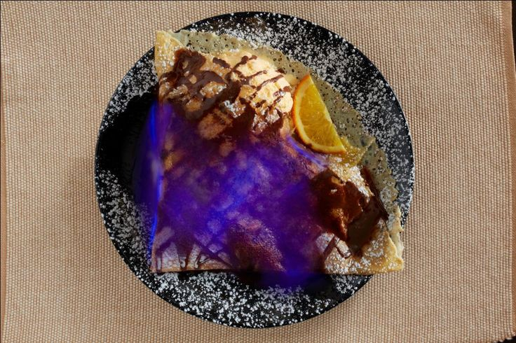 """Experience the magic of crepe flambee! Crepe Calvados @ Crepes & Co. is a classic with apples and raisins """"flamed"""" with Calvados liqueur!  Yummy!"""