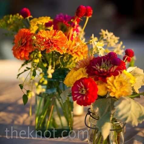 Local flowers in Mason jars were a homespun twist on traditional centerpieces.  Perfect for fall.