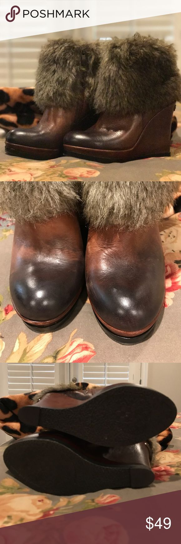 Vince Camuto fur ankle boots Vince Camuto wedge fur ankle boots. Size 6.5. Only worn twice. Beautiful burnt brown color with faux fur around the top. Such cute boots. Vince Camuto Shoes Ankle Boots & Booties