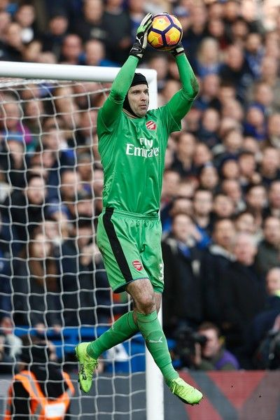 Arsenal's Czech goalkeeper Petr Cech catches the ball during the English Premier League football match between Chelsea and Arsenal at Stamford Bridge in London on February 4, 2017. / AFP / Adrian DENNIS / RESTRICTED TO EDITORIAL USE. No use with unauthorized audio, video, data, fixture lists, club/league logos or 'live' services. Online in-match use limited to 75 images, no video emulation. No use in betting, games or single club/league/player publications.  /