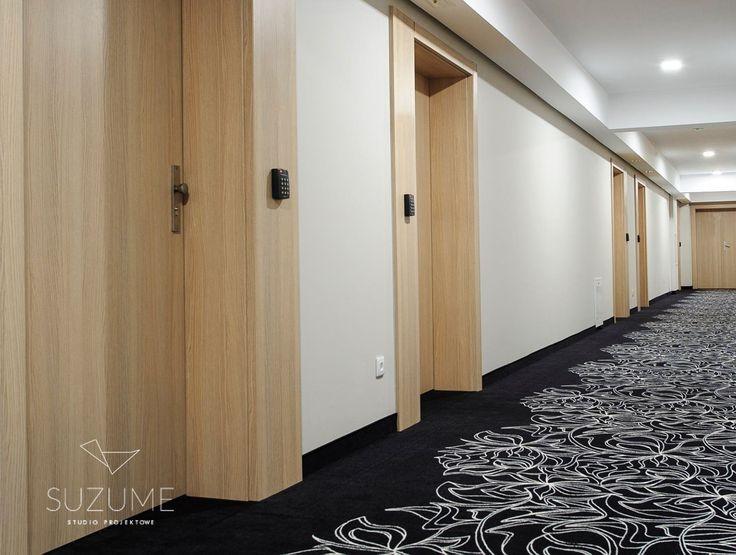 Hotel corridor. Black carpet with organic decor. Ciechocinek